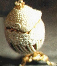 Marriage: duck egg, musical, turning,14kt gold leaf, Austrian crystals