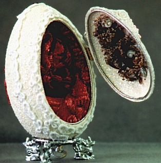 Pink Lady: goose egg, genuine soft dried flowers, egg glows in the dark, pewter base, musical